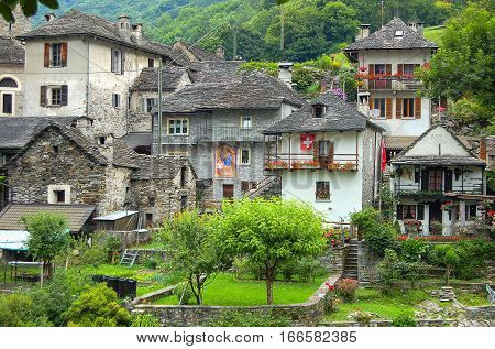 Stone houses and green gardens of Val Verzasca