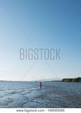 Adventure people wear life jacket stand in the ocean tele