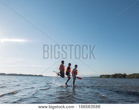 Adventure people wear life jacket jumping in the ocean