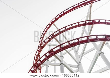 Roller coaster (red) in the amusement park isolated (copy space)