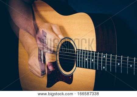 Musician's Hand Is Strumming A Yellow Acoustic Guitar