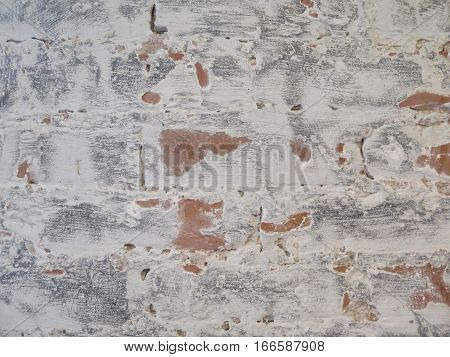 Close up view of an old red brick whitewashed wall used for background