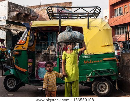 Agra, Iindia - April 17: The classical auto rickshaw is the unique vehicle style of local transportation in several Asian countries in April 17, 2009 in Agra, India.