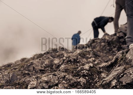 people standing at the top of the mountain