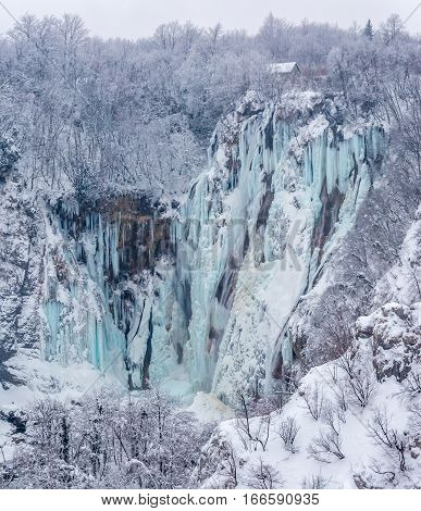 Winter panorama of frozen waterfalls at Plitvice lakes in Croatia.