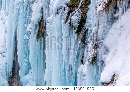 Frozen waterfalls in winter time at Plitvice lakes in Croatia.