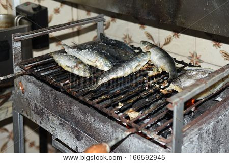Cooking Sardines in the village of Aveiro Portugal