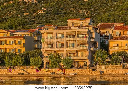 TUCEPI, CROATIA - September 20, 2016 Private houses by the sea illuminated by the sunshine.