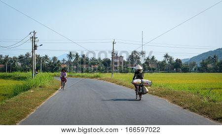 People On Countryside Road In Mekong Delta, Vietnam