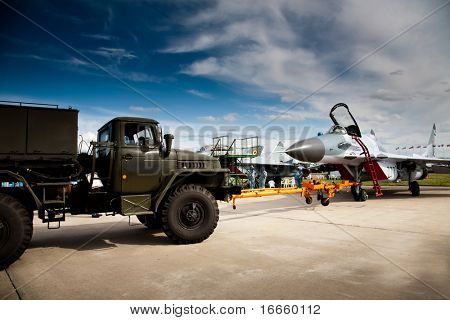 poster of Fighter Mig-29 And Truck at the International Aviation and Space salon MAKS