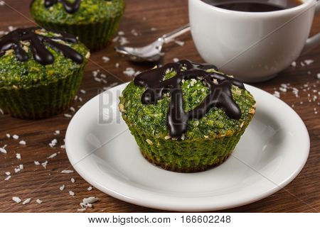 Fresh Muffins With Spinach, Desiccated Coconut, Chocolate Glaze And Cup Of Coffee, Delicious Healthy