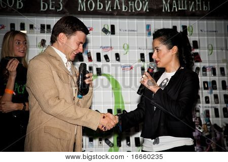 MOSCOW, RUSSIA, AUGUST,30: Russian Television Anchorwoman Tina Kandelaki and Writer Dmitry Glukhovsky at the Action - Day Without a Cellphone,  August 30, 2009 at Moscow, Russia