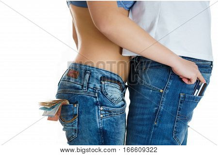 young girl in jeans and a naked stomach stealing a credit card from man