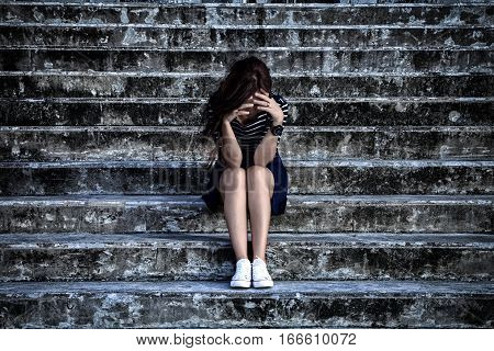 Beautiful Woman In Frustrated Depression Sitting On The Stairs, In Scary Abandoned Building. Concept