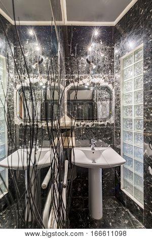 Elegant Grey Bathroom With Glossy Armature