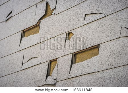 Damaged facade of an old house background