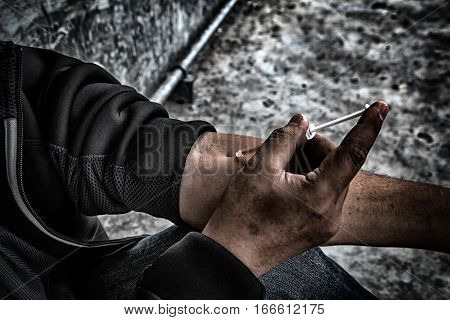 Drug Abuse Concept., Overdose Asian Male Drug Addict In Action With Drugs Narcotic Syringe In Hand.