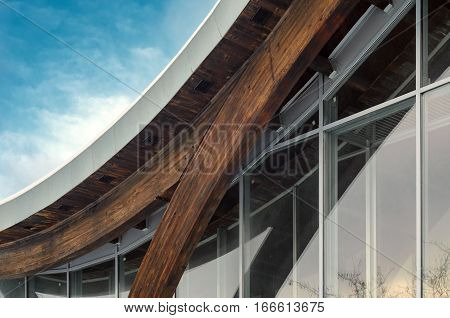 MINSK BELARUS - January 15 2017: Sports complex Olympic reserve. Pool National Olympic Training Center in athletics in Minsk Belarus. Detail of building facade. Interfacing of wooden structure glued elements.