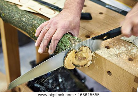Man Sawing Wood Handsaw