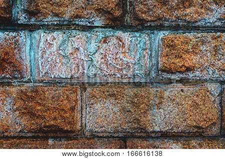 Frozen granite wall background. Laying of granite stone