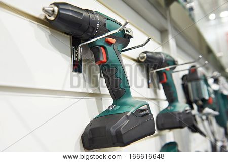 Electric Screwdriver For Construction On Stand In Shop