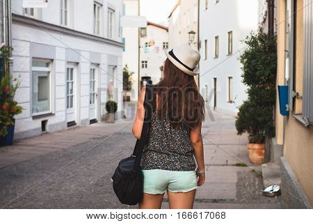 Young Girl Taking Walk On A Narrow Street Of Fussen, Austria