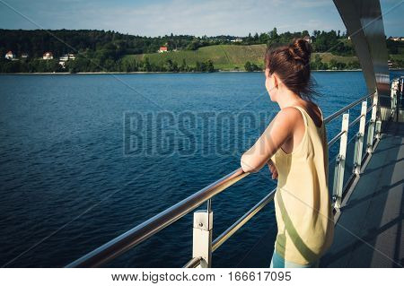 Young girl enjoying view of the Bodensee on the ferry lake Constance Germany