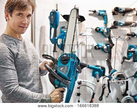 Man Chooses Chain Saw