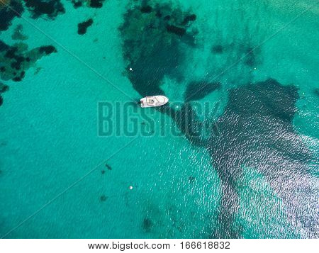 Aerial  View Of A Leisure Boat Mooring In Translucent Turquoise Mediterranean Sea Water