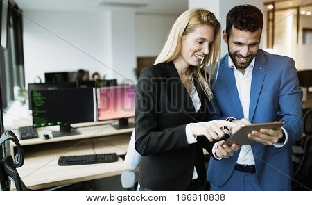 Happy Business Colleagues In Modern Office