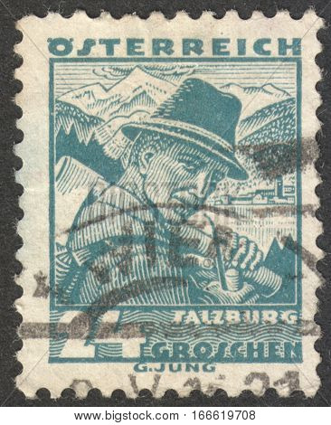 MOSCOW RUSSIA - CIRCA DECEMBER 2016: a post stamp printed in AUSTRIA shows a woodcutter from Zell Salzburg the series