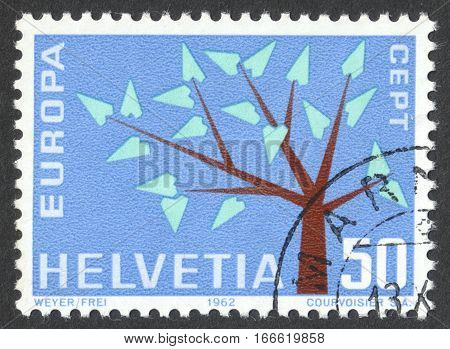 MOSCOW RUSSIA - CIRCA DECEMBER 2016: a post stamp printed in SWITZERLAND shows a stylised tree with 19 leaves the series