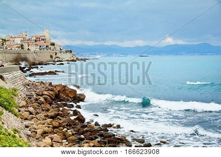 Rocky coast of Antibes France. French Riviera. Cote d'Azur. Clear blue sea. Europe.