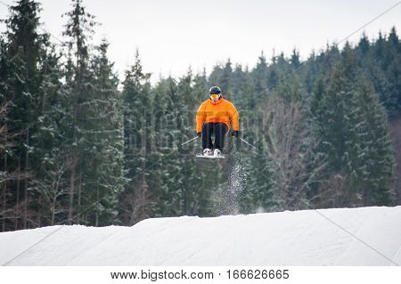 Skier At Jump From The Slope Of Mountains