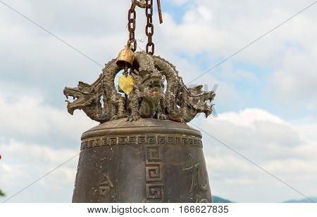 Tradition asian bell in Buddhism temple in Phuket islandThailand. Famous Big bell wish near Gold Buddha