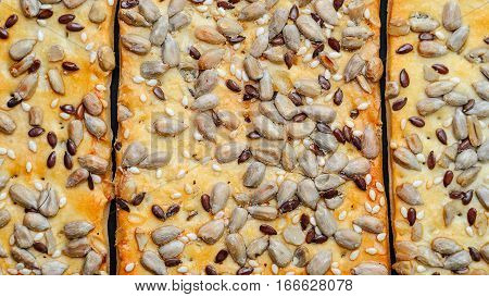 The texture of the cookie with seeds. Food pattern. Cookie Background