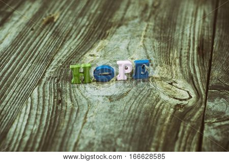 Vintage wood background wood in small letters the word hope
