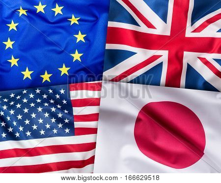 World flags concept.Collage of four countries world flags. European Union Great Britain American and Japan Flags.
