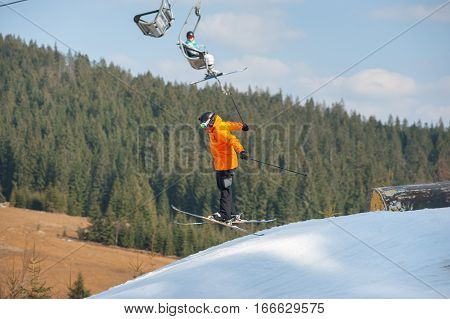 Man Skier In Flight During A Jump Over A Hurdle