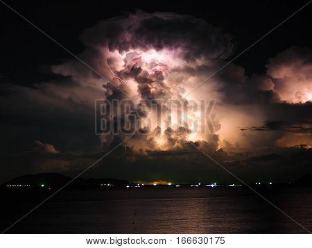 Lightning storm cloud on the sea dark tone