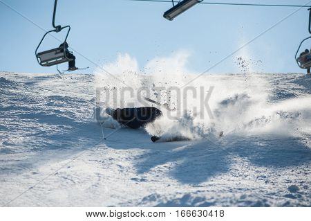 Skier Falling With Fresh Snow Powder On The Slope