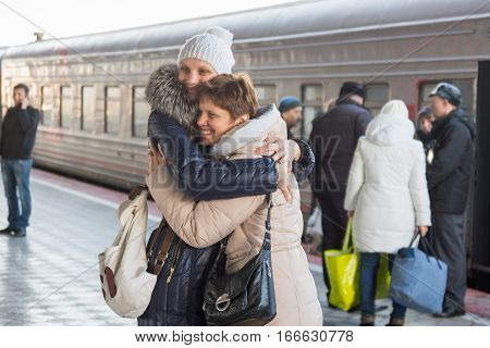 Adult daughter met my mother at the train at the station