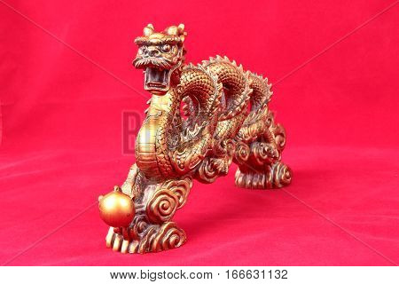 Golden Dragon Statue On Red ,to Celebrate For Chinese Festival.
