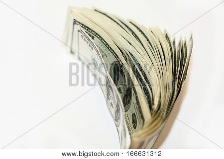 100 Dollar Bills In Large Numbers On A White Background