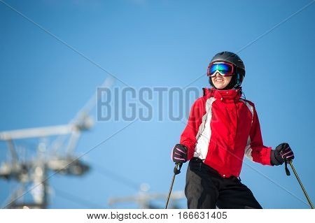 Woman Skier With Ski At Winer Resort In Sunny Day