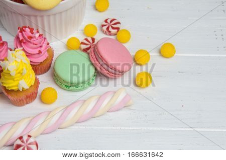 Table With Colorful Sweets: Candy, Cupcakes, Macaroons And Marshmallows