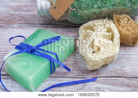 Handmade Soap, Loofah And Bath Salt On A Wooden Background