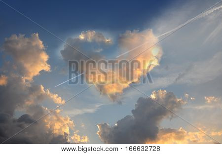 Love is in the air. Burning heart. Fluffy cloud of the shape of heart on a deep blue sky.