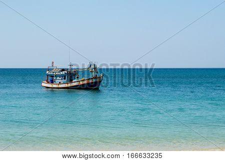 fishing boat in blue sea Andaman ocean Thailand