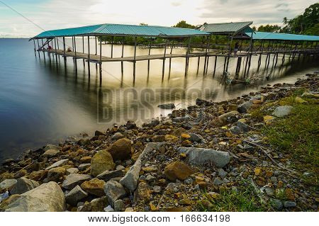 Blue hour scenery of old fisherman jetty before sunset with long exposure.